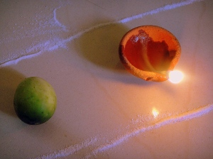 The humble 'karit' and a diya...symbols of a Goan Diwali.