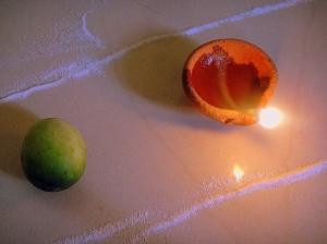 The humble 'karit' and a diya...symbols of a Goan Diwali.