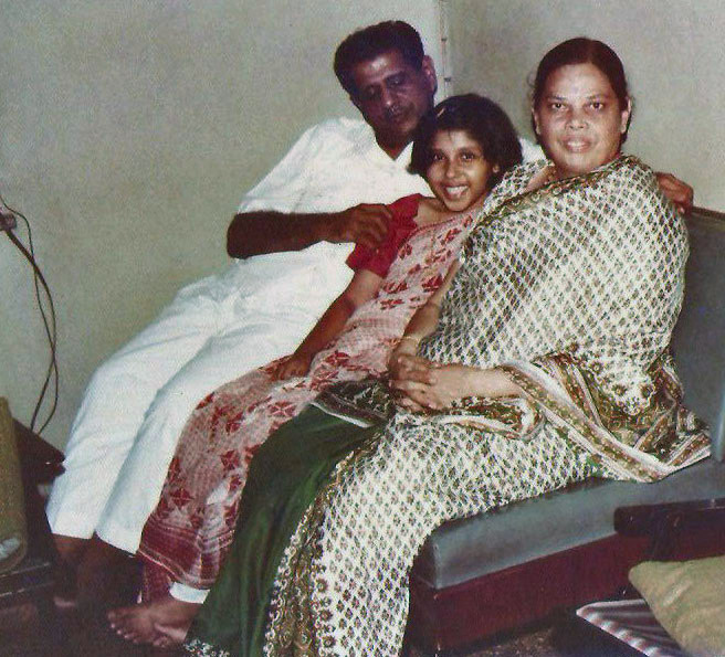 A 10-yr-old me dressed in my first sari with Aboda & Ma.