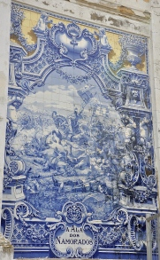 An ancient tile mural on an old building in Lisbon.